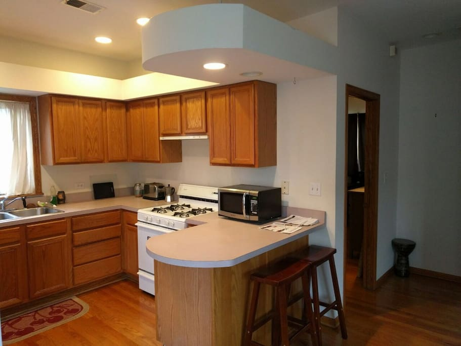 Spacious kitchen with microwave and oven/stovetop.