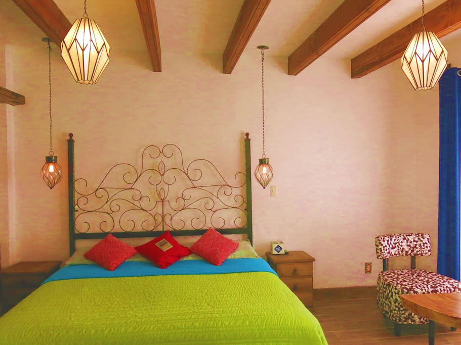 Spacious room with wooden beams on the ceiling.