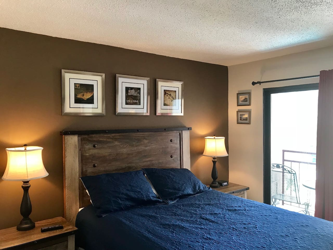 Master bedroom with comfy queen bed and spacious whirlpool tub for two.