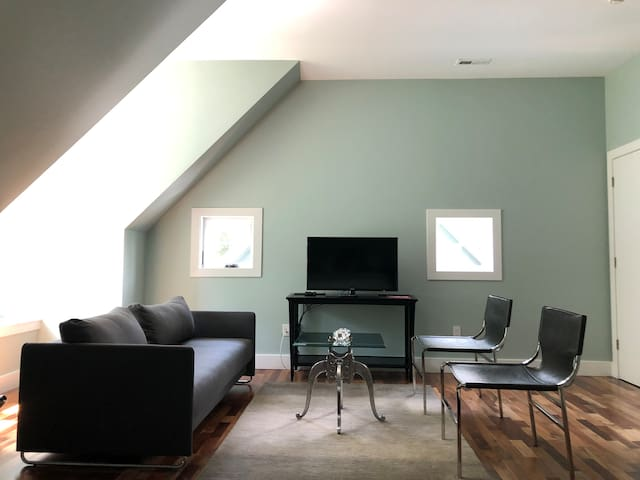 Flat screen with wide range of cable and smart TV options. Sofa is a flip down heavenly sleeper for extra guests. Enjoy the living area in you extra large king size suite!