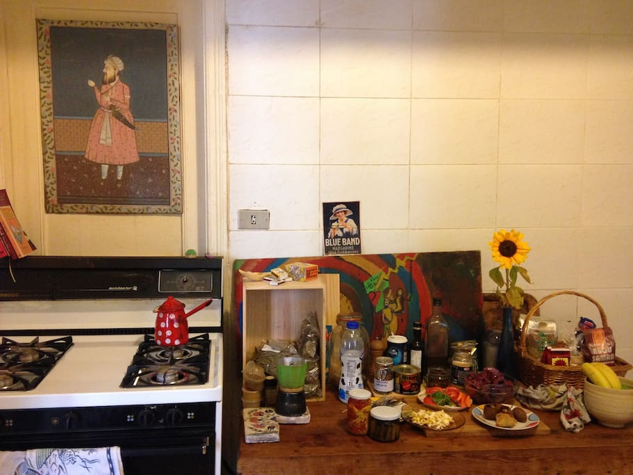 Colourful kitchen. Gas stove and oven with other essential items