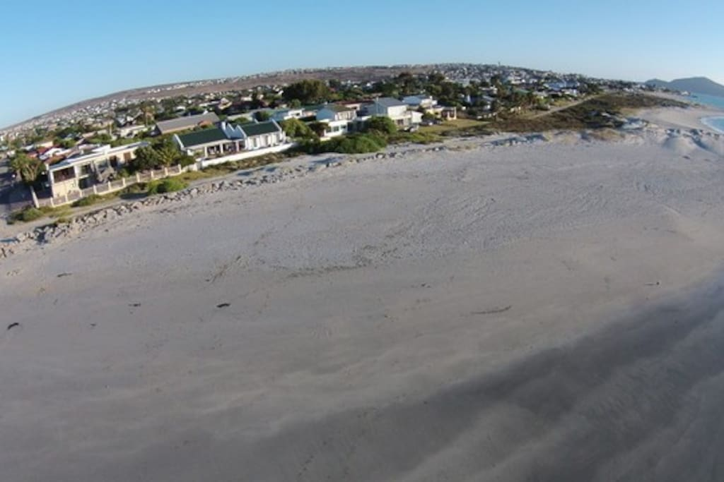 Aerial view of house and the beach.