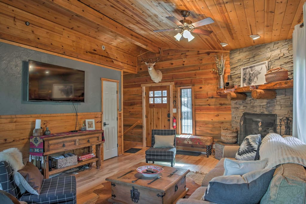 Surrounded by towering trees in a secluded setting, this true log cabin makes it easy to reconnect with nature.
