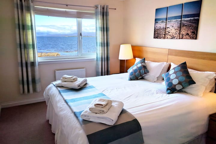Bedroom 1 with super kingsize or twin beds and en-suite shower room.