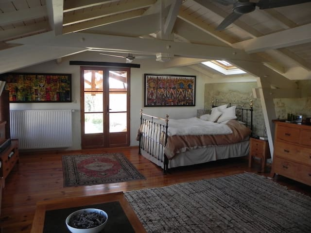 The master bedroom has its own private ensuite bathroom and balcony overlooking the pool with views of the Pyrenees.