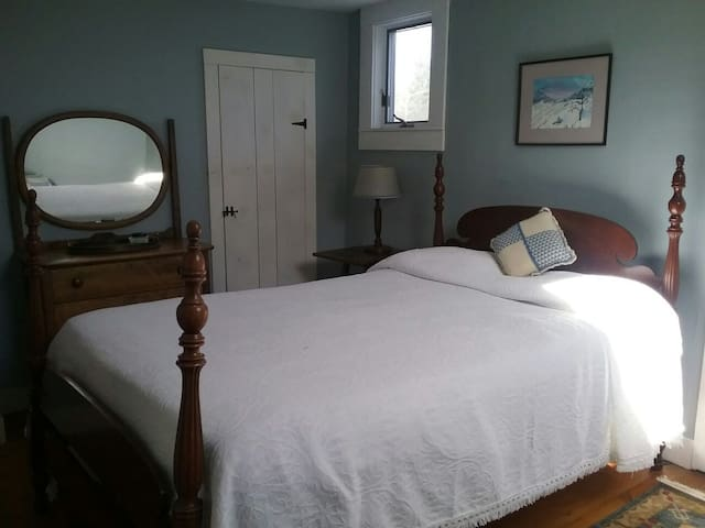 Upstairs queen bedroom with its own full bath (shower).