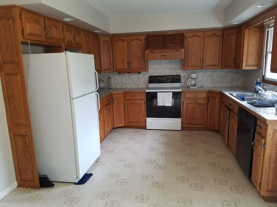 Nice Big Kitchen, with Coffee Pot, Toaster, Crock Pot, blender, and much more.