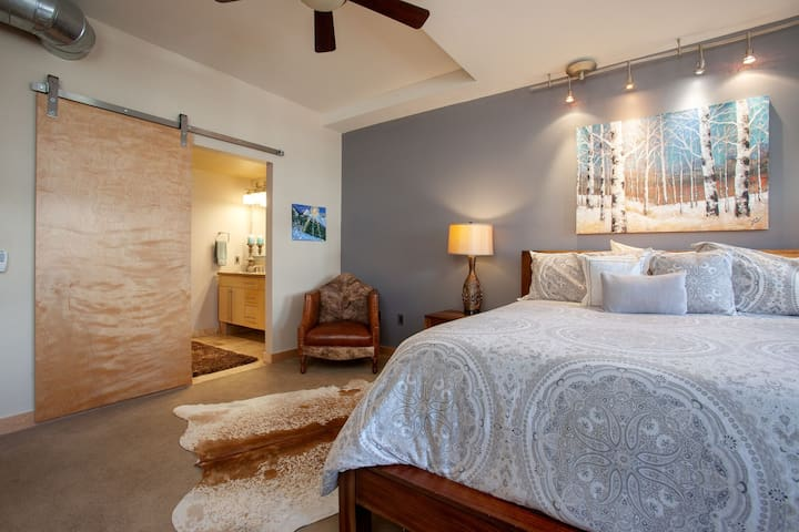 Massive Master bedroom with King sized bed and a couple sitting areas to enjoy a good book or morning coffee. Sliding maple barn door to close off spa like bathroom complete with soaking tub, shower, double sinks and walk in closet. WOW!