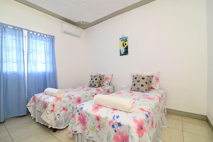 Bedroom 2 in Roof Grande. Has 2 twin beds.