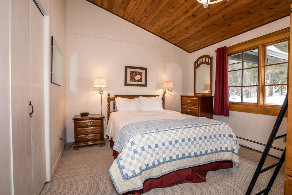Bedroom with queen bed and bunk beds