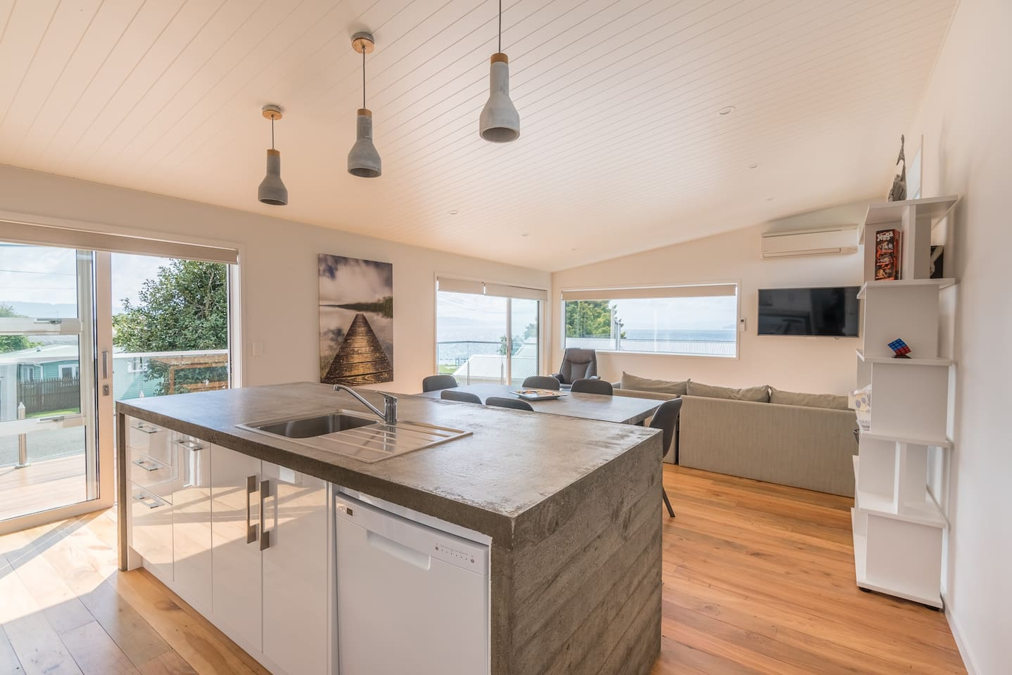Best airbnbs in Rotorua for families featured by top family travel blogger, Marcie in Mommyland: Stylish open plan living/ dining / kitchen