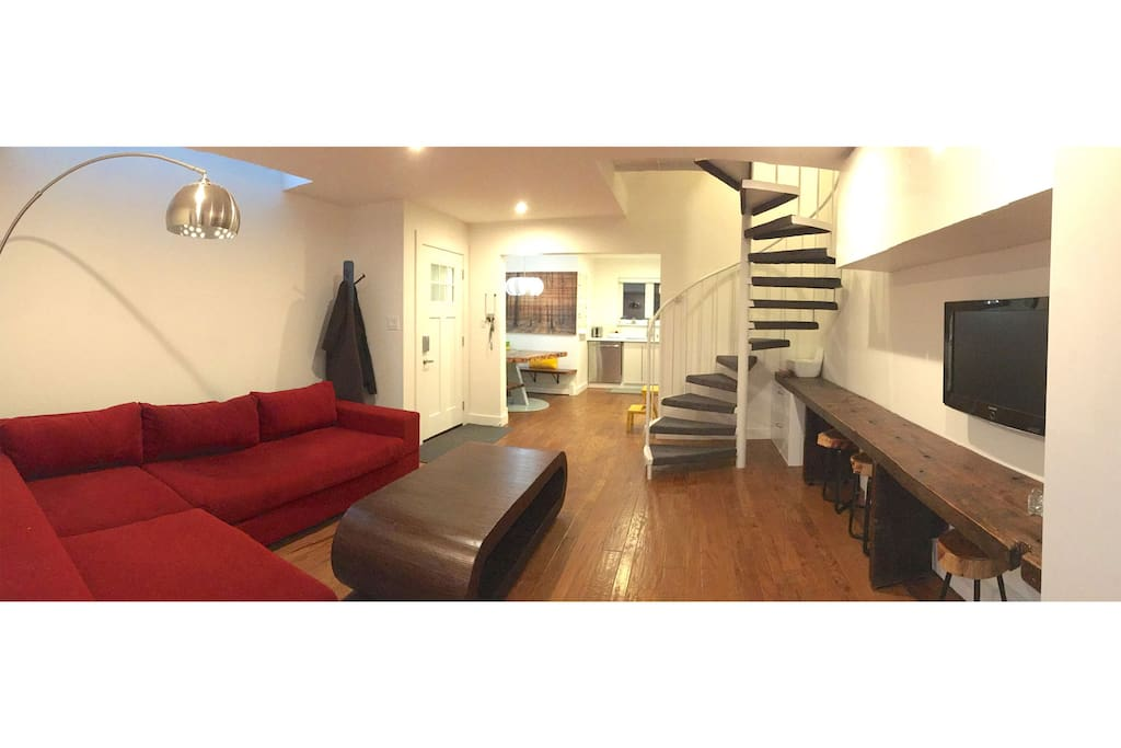 "Large ""L"" couch, great lighting, spiral staircase leading to bedroom, bathrooms and rooftop deck"