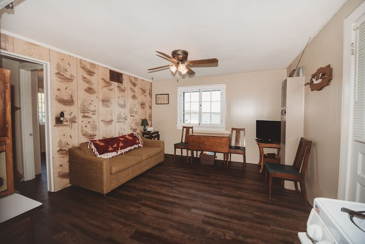 Comfortable living room with amazing views of the lake plus a pull out bed that sleeps 2!