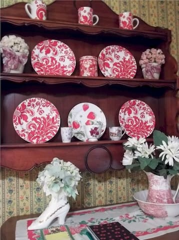 Red and white dishes add charm along with flowers.