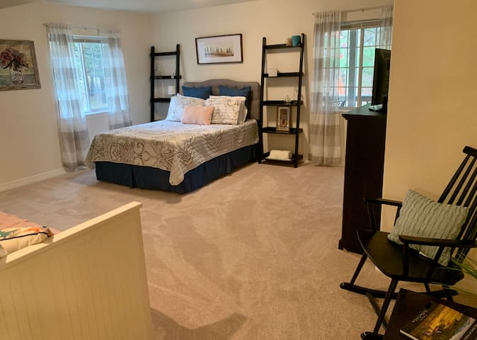 Bedroom with queen size bed, twin size bed and sitting area