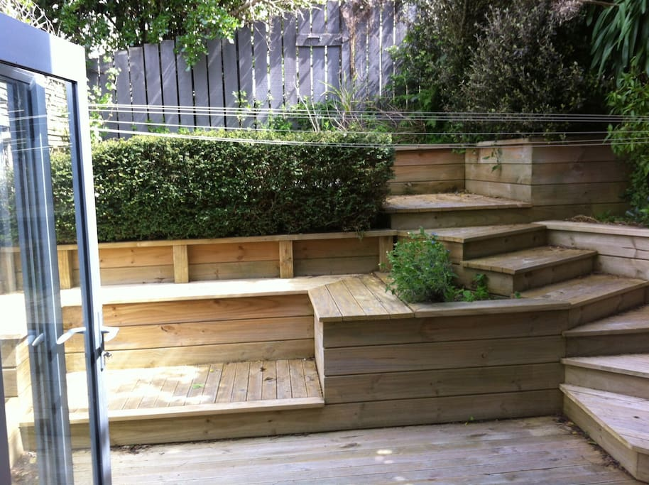 Layered decking area out back from the patio door, which your welcome to chill on