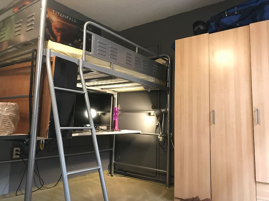 this is a loft bed over a desk