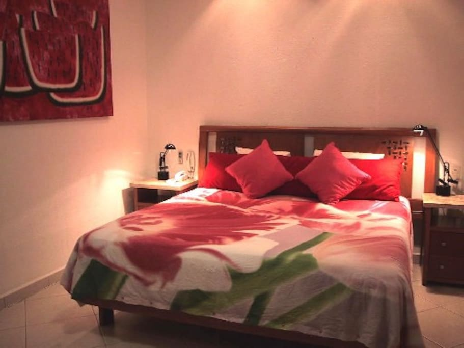 Really comfortable king bed.  Bedroom also has a teak desk, TV and WiFi
