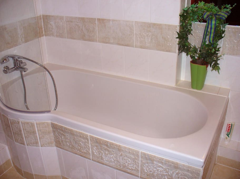 bath with bathtub + shower