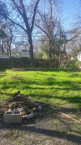 Our giant backyard with stage and fire pit