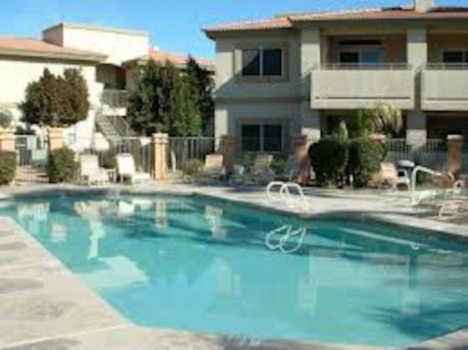 one of 3 heated pools and spas w/ bb q grills, tennis & basketball
