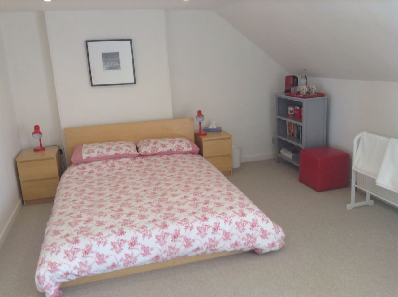 Spacious double bedroom with tea and coffee making facilities.