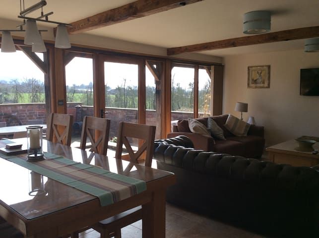 The living area leading onto garden area with lovely views