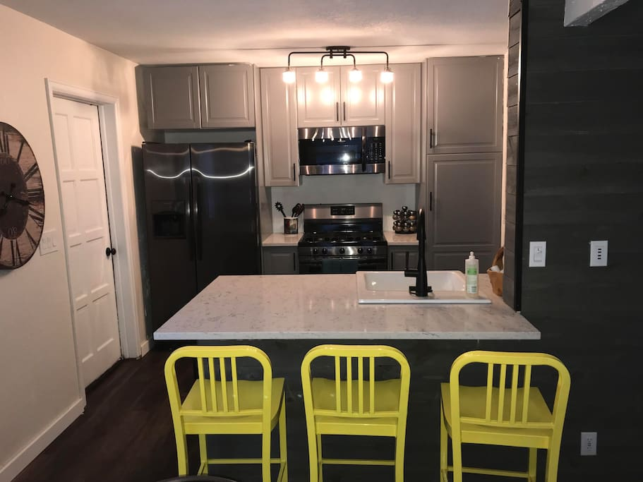 Kitchen with new appliances and granite countertops
