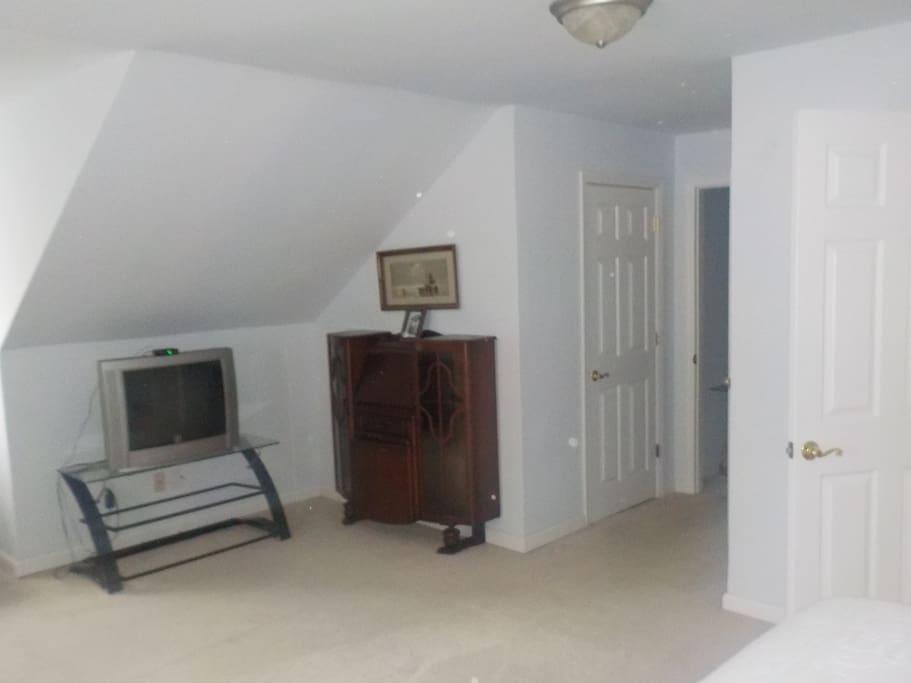 TV, desk a d door to hallway
