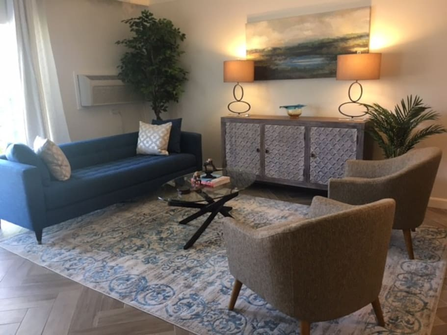 Newly furnished living room provides ample space.