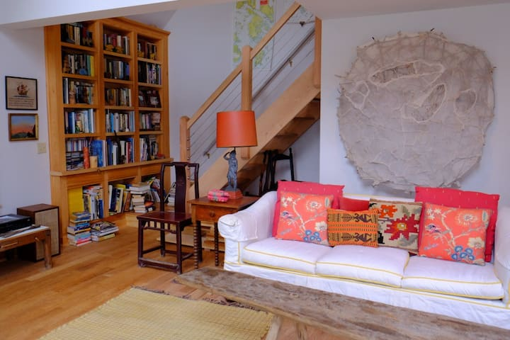 Living room with a wall art by artist Barbara Andrus