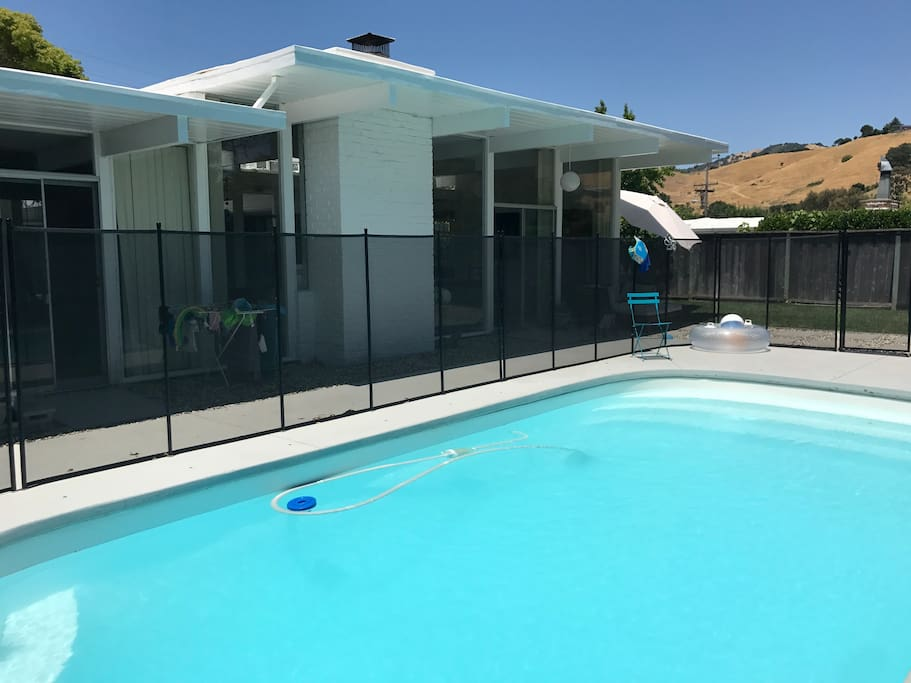 Pool is protected with a 5 foot self-closing fence