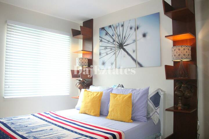 One Spatial 1 Bedroom by DajEztates