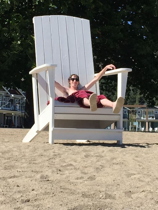 Relax in the huge adirondack chair on the beach!