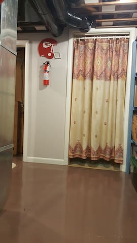 Privacy Curtain to Bathroom. (Note: Fire Extinguisher Mounted on Wall)