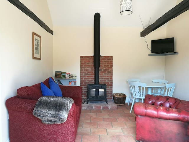 the lounge/diner with log burner and sofa bed