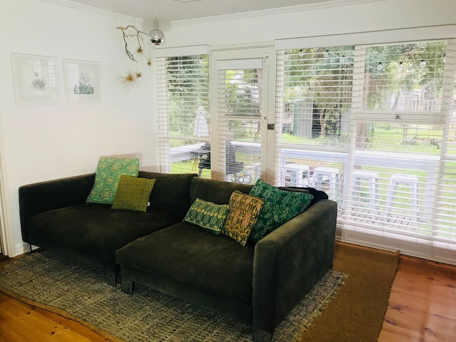 Oversized Jardan Lounge overlooking garden with easy access to rear deck.