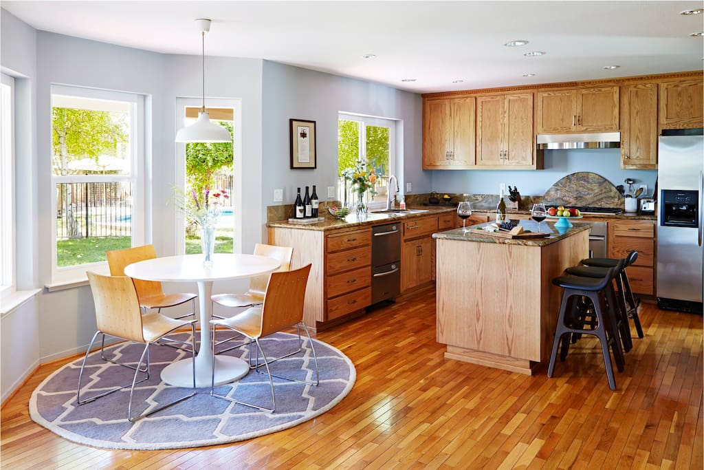 Spacious eat-in, fully stocked kitchen with exceptional backyard views
