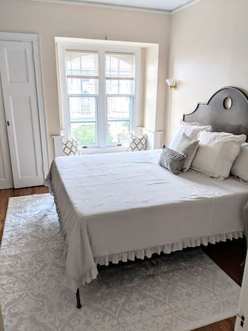 Temperpedic King Bedroom with views of the historic Milwaukee Public Library and a window seat for your luggage!
