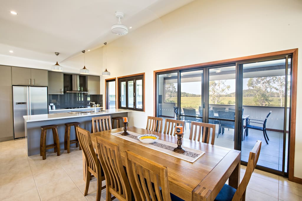 Modern open dining and kitchen area opening out to large verandah. Kitchen fully equipped with modern appliances.