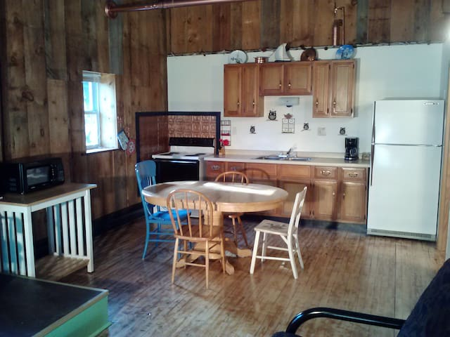 The kitchen includes a full sized stove/oven, refrigerator and a microwave oven.