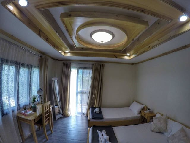 1 queen size and 1 single bed good for 3 persons with toilet and Bath and with balcony