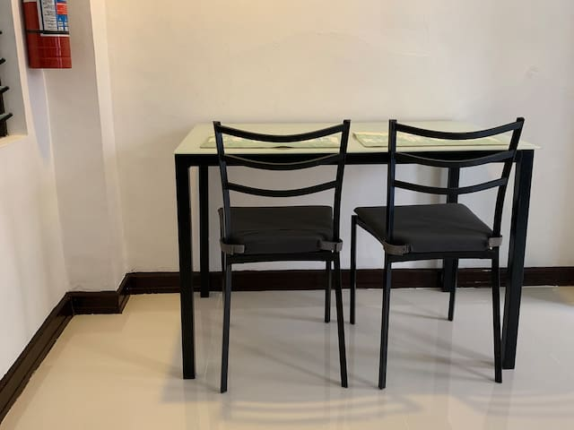 Dining or workspace table with comfortable seats. We provide plates, utensils, glasses and water heater, which are not pictured here.