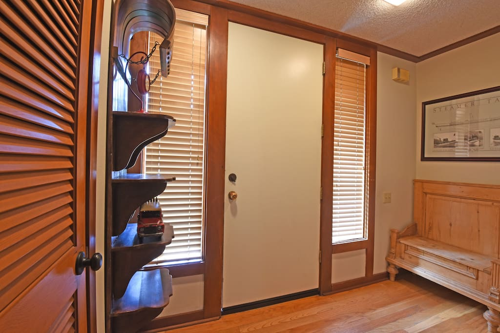 Front door and foyer  - great place to store skis and summer equipment