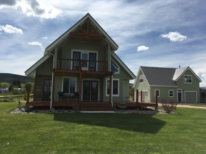 Bear Lake Farmhouse/Cabin with lake side view.