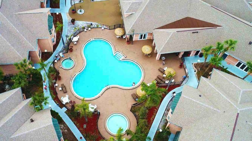 Aerial view of the pool; clubhouse top right; Building 1 bottom right