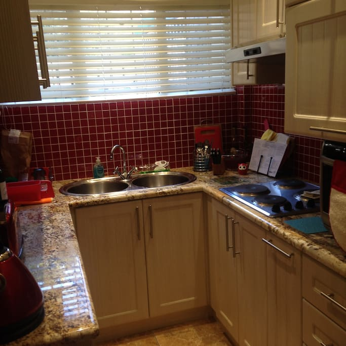 Compact Kitchen with hob and convection oven, fridge and freezer, kettle, toaster  all the necessary kitchen utensils!
