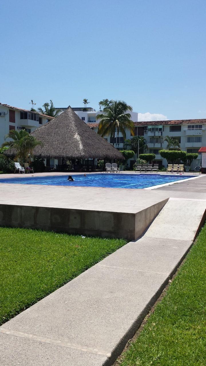 Habitacion en condominio compartido con piscina