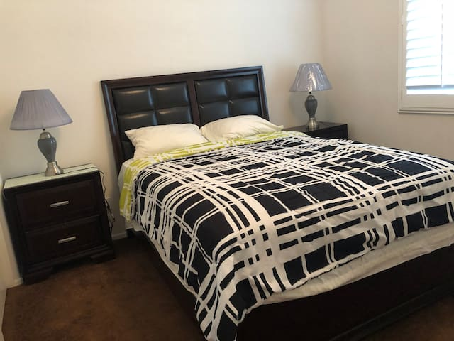 Small masters bedroom welcomes female guests