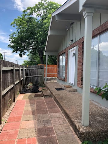 Fenced courtyard patio and entry.